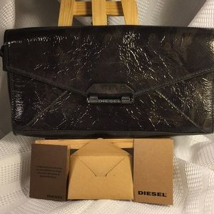 Diesel NWOT leather clutch never used clean inside